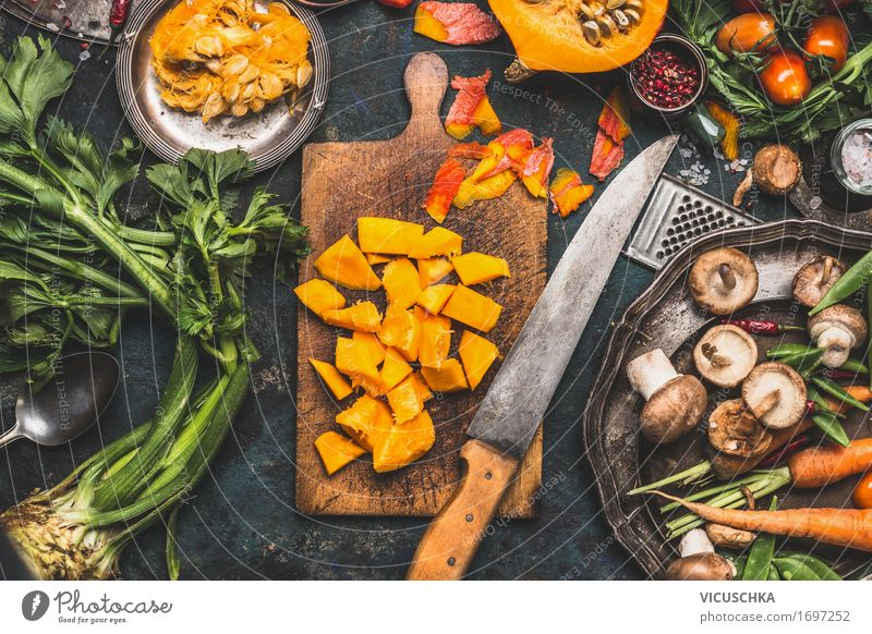 Chopped pumpkin on rustic chopping board with kitchen knife Food Vegetable Herbs and spices Nutrition Lunch Dinner Banquet Organic produce Vegetarian diet Diet