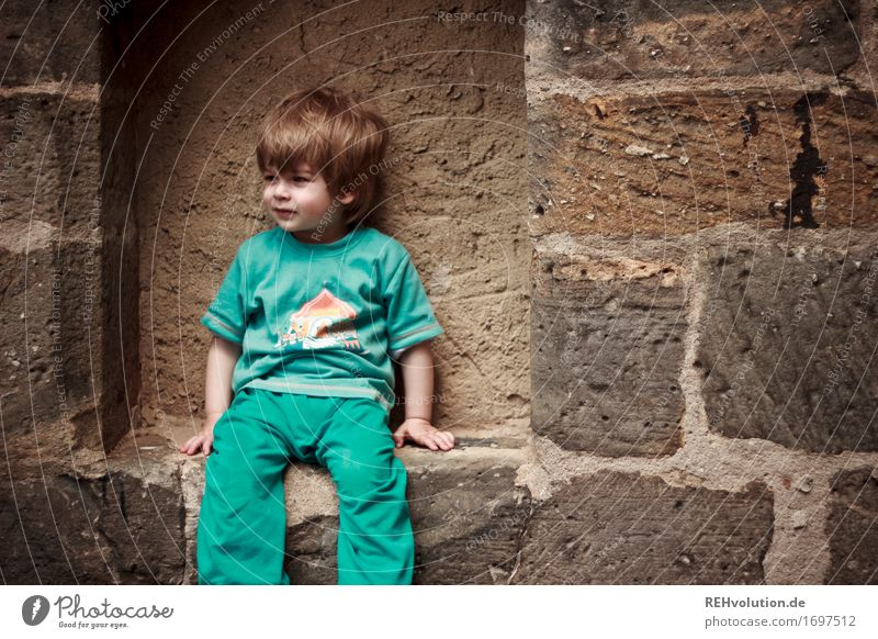 Human being Child Blue Relaxation Wall (building) Boy (child) Wall (barrier) Small Stone Hair and hairstyles Masculine Free Sit Infancy Wait Observe