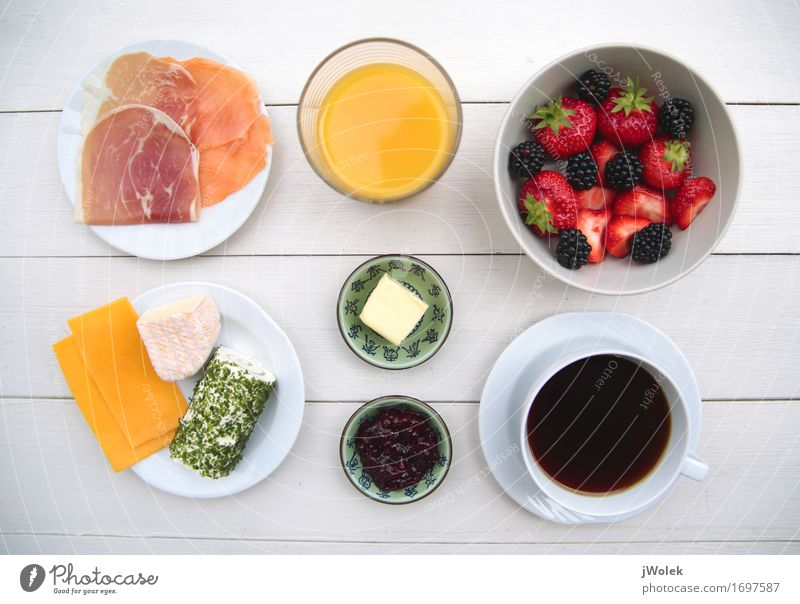 ingredients of a tasty breakfast Food Sausage Fish Cheese Dairy Products Fruit Orange Jam Breakfast Hot drink Juice Coffee Crockery Bowl Cup Life Kitchen