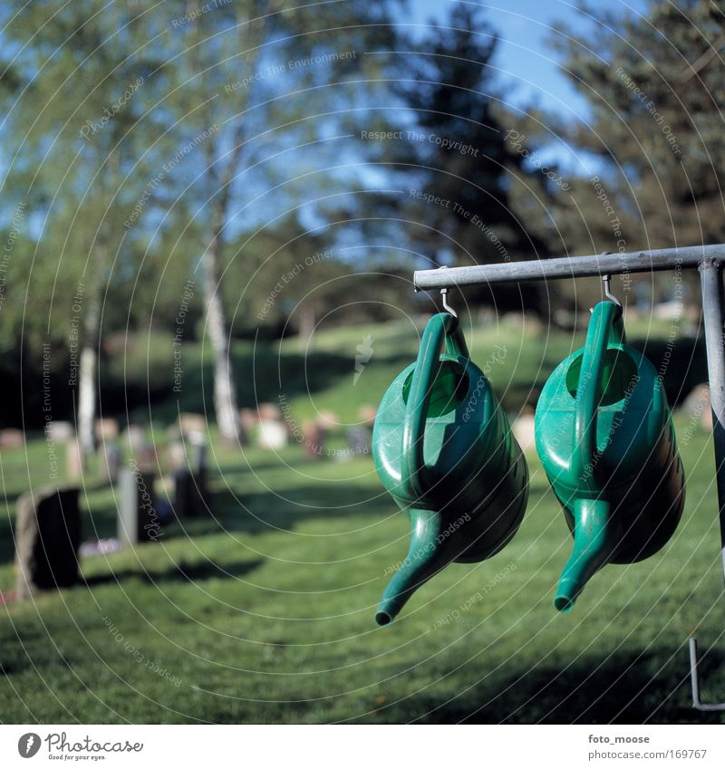 Watering Post Colour photo Exterior shot Deserted Day Shallow depth of field Garden Summer Watering can Plastic Hang Green Peaceful Calm Death Esthetic