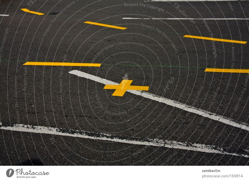 Several strokes and a cross Street Road traffic Traffic lane Lane markings Signs and labeling Information Line Direction Orientation Lanes & trails System Rule