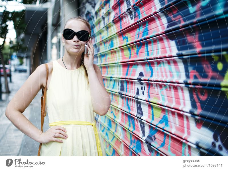 Woman in sunglasses chatting on a mobile Lifestyle Style Happy Beautiful Handcrafts Summer Work and employment Business To talk Telephone Cellphone PDA