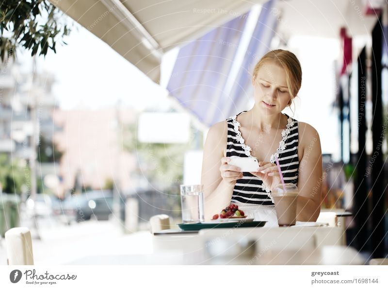 Attractive woman taking picture of a pastry on her mobile Human being Woman Youth (Young adults) Summer Beautiful Young woman Joy Girl 18 - 30 years Adults Eating Lifestyle Laughter Happy Together Fruit