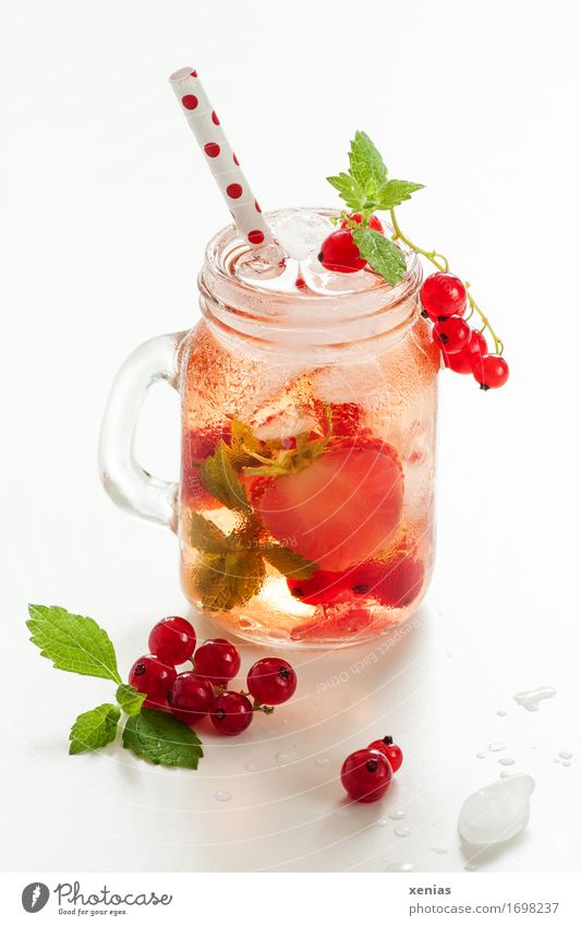 A glass of cool delicious soft drink with strawberry and currant on white background Beverage Redcurrant Strawberry Cold drink Lemonade Fruit Drinking water