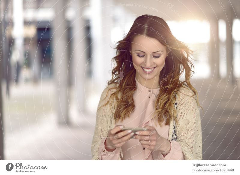 Young woman texting on her mobile phone Human being Woman Vacation & Travel Youth (Young adults) City Beautiful 18 - 30 years Adults Street Feminine Lifestyle Fashion Modern Action Technology Smiling