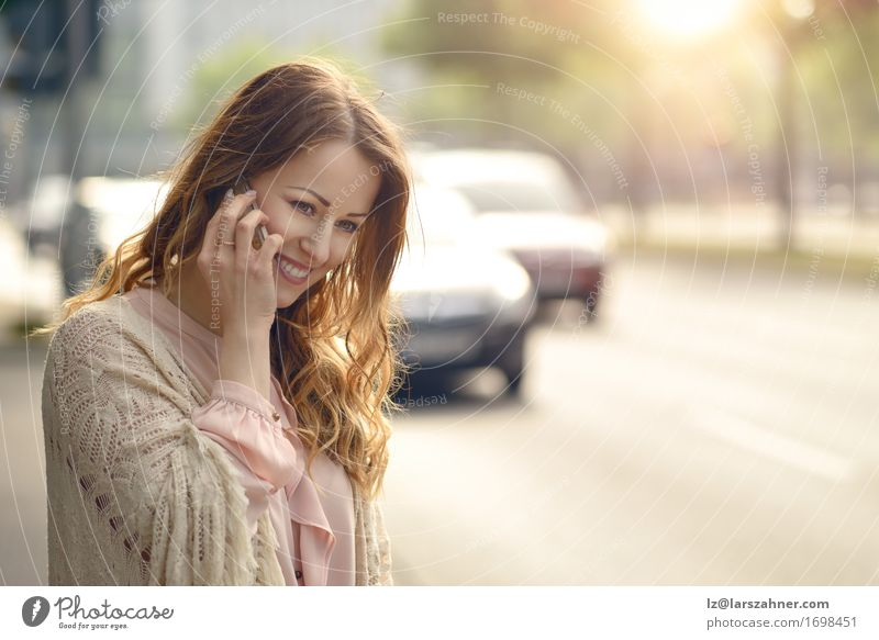 Attractive young woman talking on her mobile phone Human being Woman Youth (Young adults) Summer Beautiful 18 - 30 years Face Adults Street Warmth To talk Feminine Happy Transport Copy Space Car