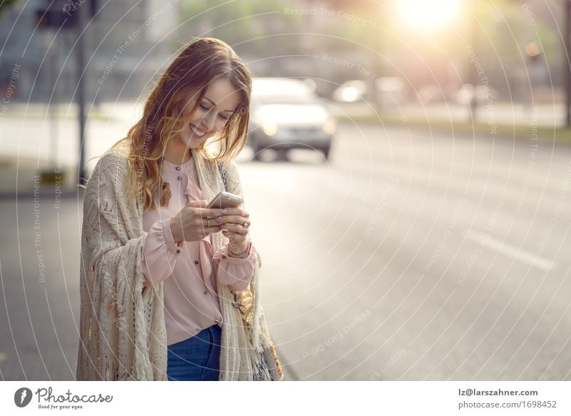 Attractive young woman checking her mobile Human being Woman Youth (Young adults) Summer Beautiful 18 - 30 years Face Adults Street Warmth Feminine Happy Transport Copy Space Car Blonde
