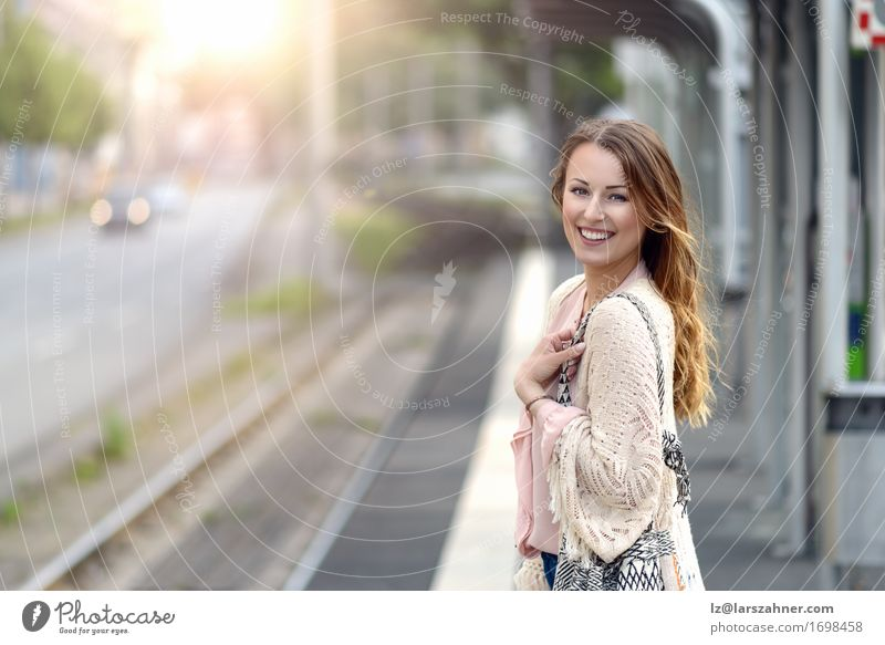 Stylish young woman waiting on a platform Lifestyle Happy Beautiful Face Summer Technology Feminine Woman Adults 1 Human being 18 - 30 years