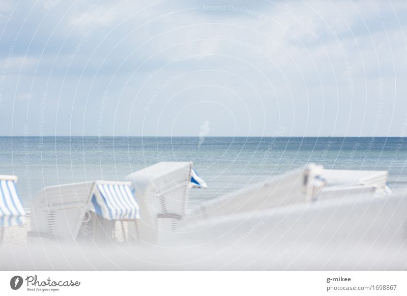 Beach chairs at the Baltic Sea Water Summer Swimming & Bathing Discover Relaxation Bright Calm Blue Vacation & Travel Ocean Travel photography Rügen