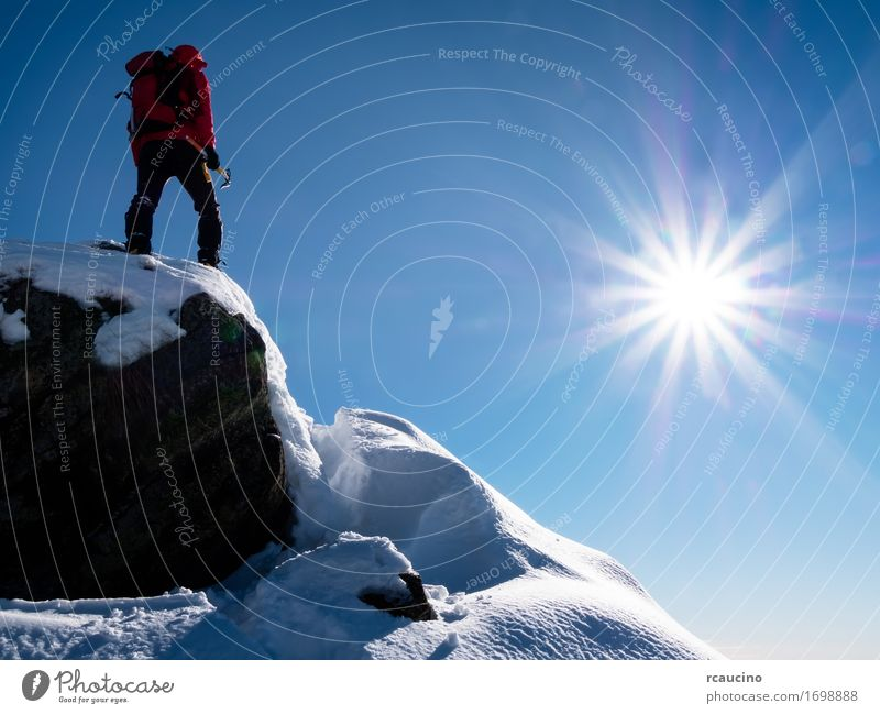 Mountaineer at the summit. Human being Sky Nature Vacation & Travel Man Blue Sun Landscape Red Joy Winter Adults Sports Freedom Power