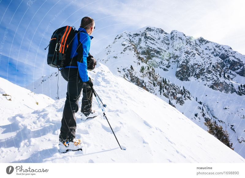 Winter vacation: mountaineer takes a rest Human being Sky Nature Vacation & Travel Man Blue White Landscape Loneliness Joy Winter Mountain Adults Lanes & trails Sports Snow
