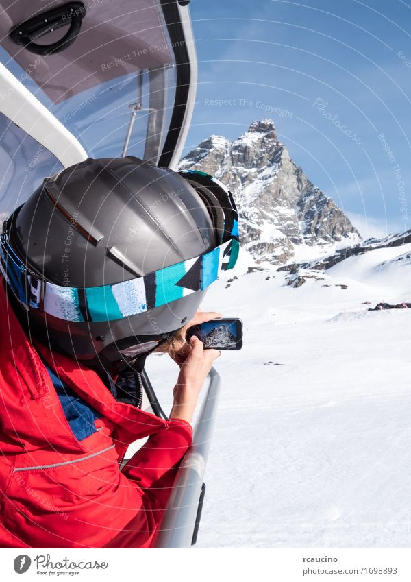 A young boy takes a photo of the Matterhorn Lifestyle Beautiful Vacation & Travel Tourism Winter Snow Mountain Sports Skiing Child PDA Camera Human being