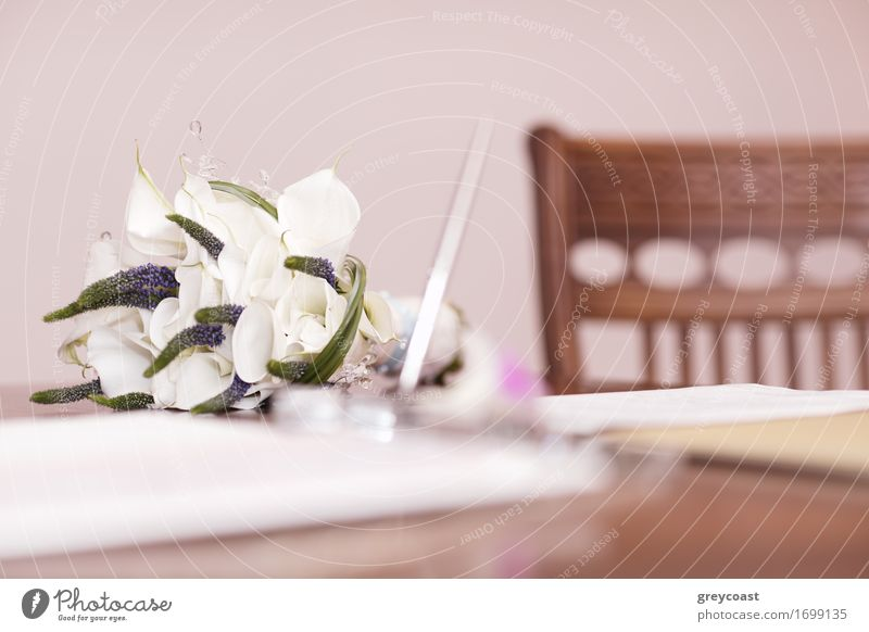Low angle view of a pretty wedding bouquet of white flowers lying on a table top with selective focus and copyspace Luxury Elegant Happy Beautiful Decoration