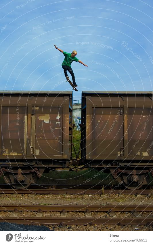 Jump over 2 wagons Colour photo Exterior shot Lifestyle Elegant Sports Means of transport Discover Aggression Skateboard Skateboarding Thrill Day