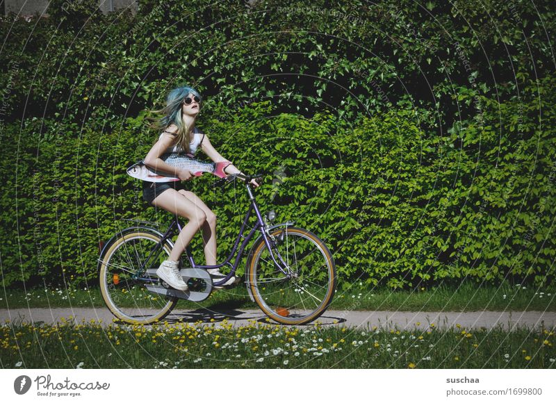 fish & bike Exterior shot Summer Spring Green Bicycle Cycling Child Youth (Young adults) Young woman Girl Wig Fish Whimsical Strange Action Idea Infancy Puberty