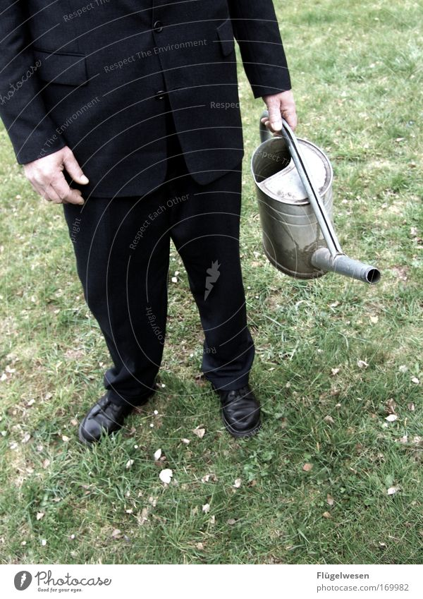 """Herbert pours the lawn """"black"""" again... Colour photo Exterior shot Feet Environment Nature Park Meadow Suit Footwear Work and employment Growth Sustainability"""