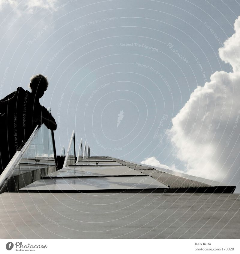 Wot time. Is it? Human being Masculine Man Adults 1 Bank building Manmade structures Building Architecture Wall (barrier) Wall (building) Stairs Facade Balcony