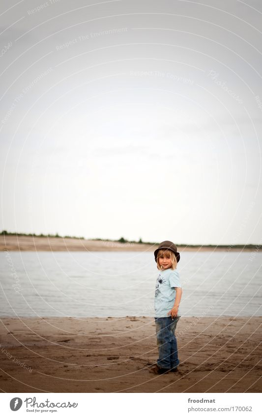 little man at the little sea Colour photo Subdued colour Exterior shot Copy Space top Day Wide angle Full-length Looking into the camera Human being Masculine