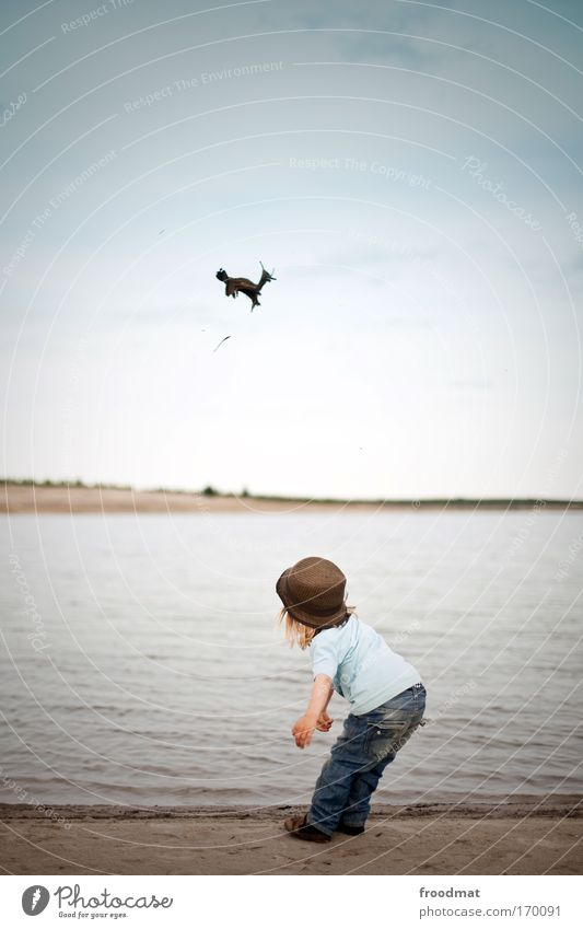 Human being Child Sky Joy Playing Happy Coast Style Infancy Masculine Happiness Cool (slang) Cute Jeans Beautiful weather Toddler