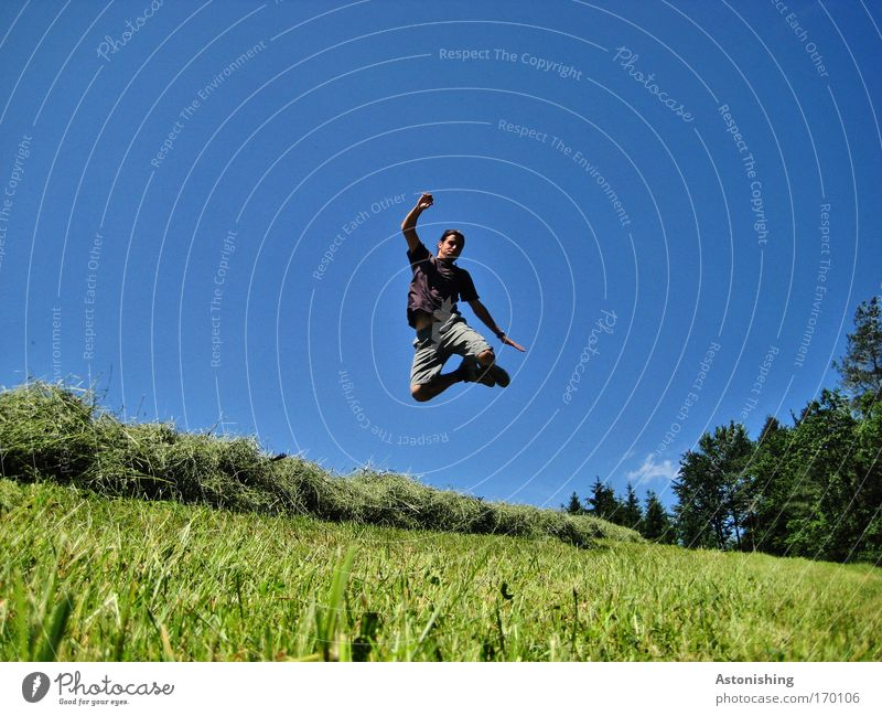 hurdle jump Colour photo Exterior shot Copy Space left Copy Space right Day Shadow Contrast Human being Masculine Young man Youth (Young adults) 1 18 - 30 years