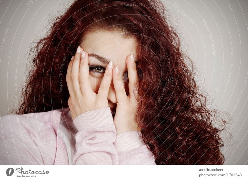 young woman peeking through fingers Joy Human being Feminine Young woman Youth (Young adults) Woman Adults 1 13 - 18 years Long-haired Curl Curiosity Emotions
