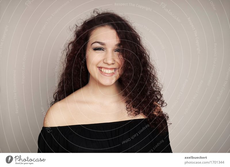 smiling teenage girl with curly hair Human being Woman Youth (Young adults) Young woman Joy Girl Adults Emotions Feminine Laughter Copy Space 13 - 18 years