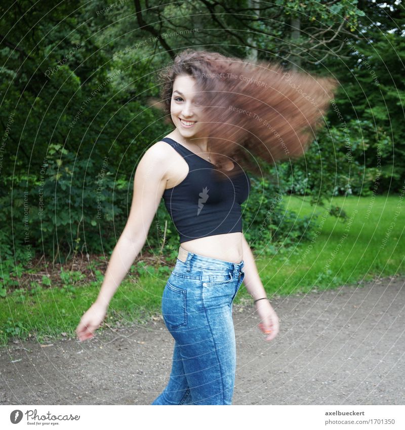 young woman shakes her hair Lifestyle Joy Hair and hairstyles Human being Feminine Girl Young woman Youth (Young adults) Woman Adults 1 13 - 18 years Nature