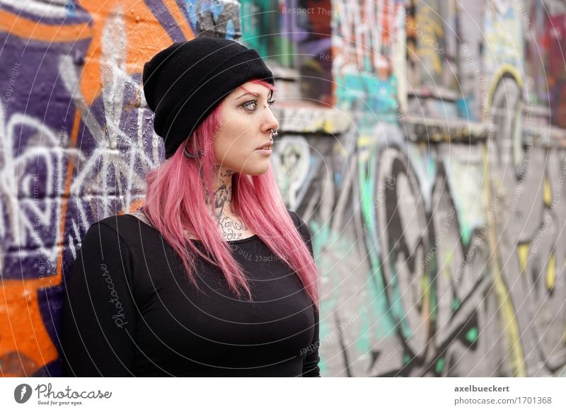 young woman leaning against graffiti wall Human being Woman Youth (Young adults) Young woman 18 - 30 years Adults Wall (building) Graffiti Feminine Lifestyle Building Wall (barrier) Fashion Copy Space Authentic Youth culture
