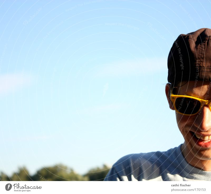 yellow glasses Colour photo Exterior shot Day Light Shadow Contrast Sunlight Central perspective Portrait photograph Downward Joy Summer Human being Masculine