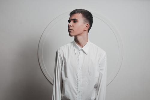young boy in white Young man Youth (Young adults) 1 Human being 13 - 18 years 18 - 30 years Adults Fashion Shirt Brunette Short-haired Circle Esthetic Thin