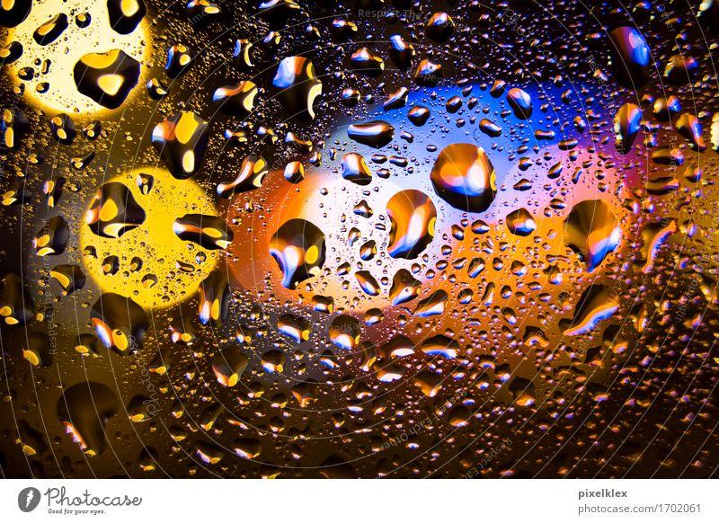 Raindrops at the window Night life Water Drops of water Bad weather Deserted Glass Illuminate Glittering Wet Blue Yellow Orange Light Slice Window pane Blur