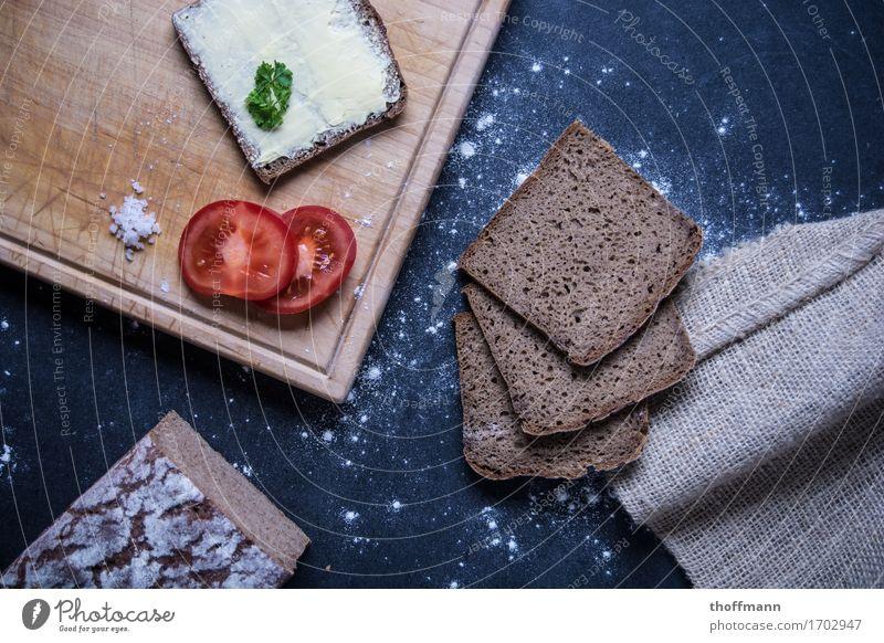 Enjoy a snack Sandwich Bütterken Bread Brunch Herbs and spices Flour butter knife Knives Chopping board Wood Wooden board Subsoil Dark Studio shot Nutrition