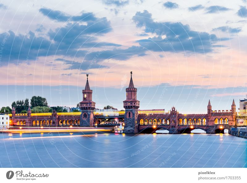 Oberbaum bridge with subway and boat at night Vacation & Travel Tourism Sightseeing City trip Water Clouds Sunrise Sunset River Spree Berlin Oberbaum City