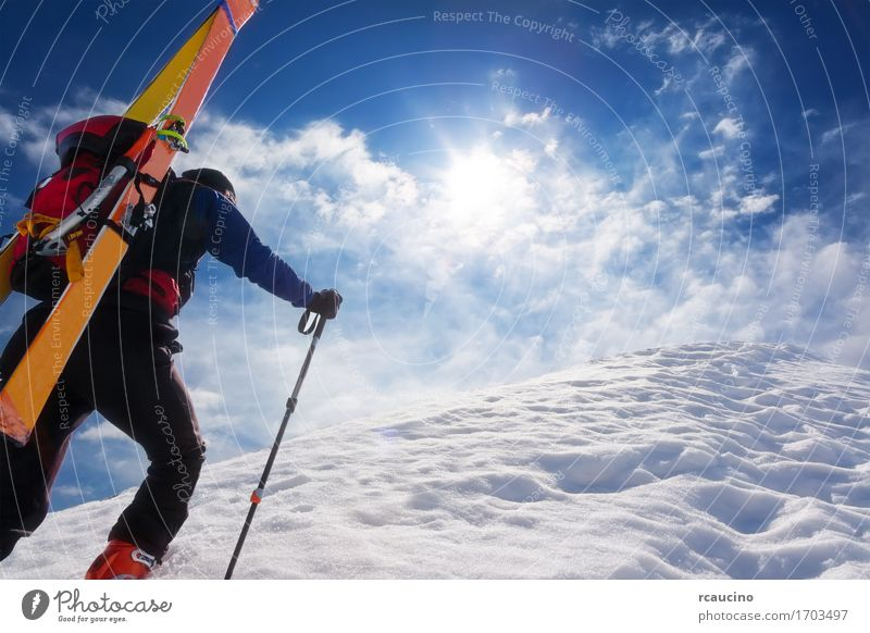 Ski mountaineer walking up along a steep snowy ridge Human being Sky Vacation & Travel Man Blue White Loneliness Clouds Winter Mountain Adults Sports Snow