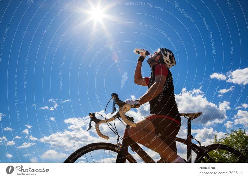 Cyclist resting and drinking isotonic drink Human being Sky Nature Vacation & Travel Man Summer Sun Relaxation Red Joy Adults Sports Lifestyle Freedom Leisure and hobbies Power