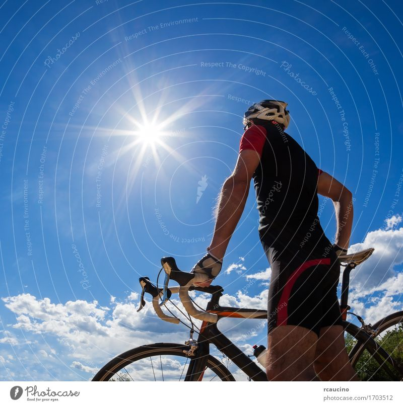 Road cyclist resting on his bike Human being Sky Nature Vacation & Travel Man Summer Sun Relaxation Red Loneliness Joy Black Adults Street Sports Lifestyle