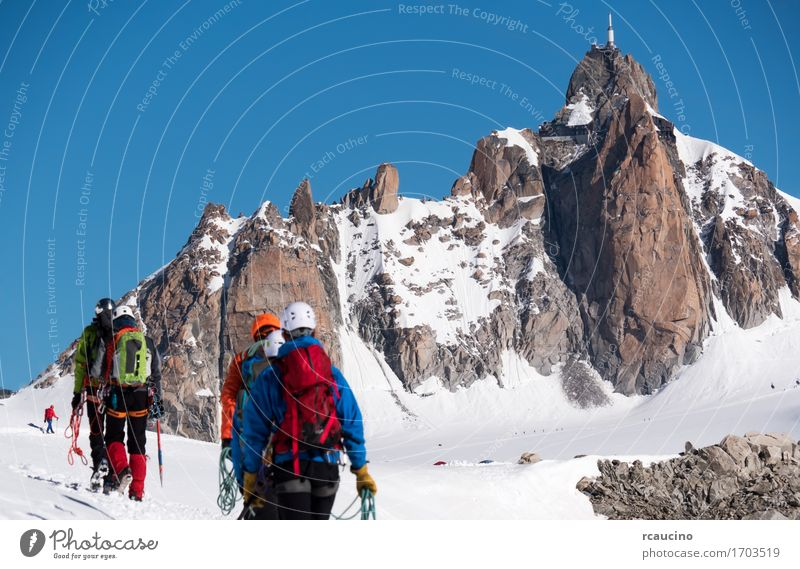 Aiguille du Midi and mountaineers. Mont Blanc Chamonix, France Vacation & Travel Tourism Adventure Expedition Winter Snow Mountain Hiking Sports Climbing