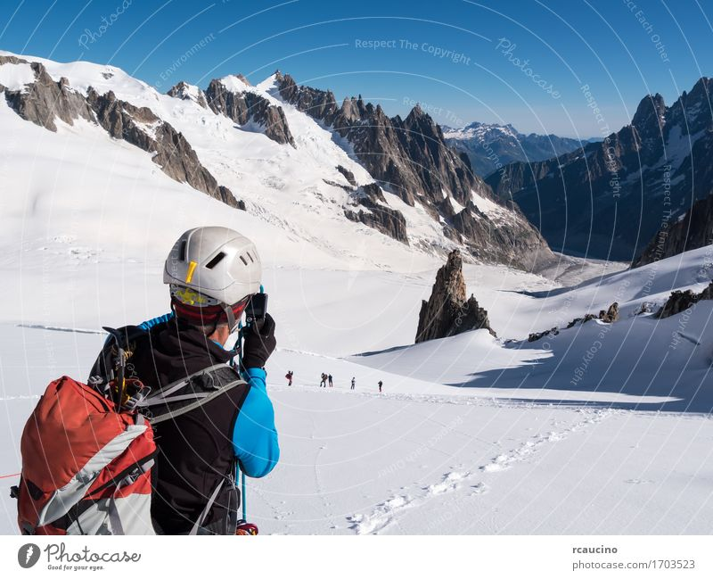 Mountaineer taking picture with a camera. Mont Blanc Glacier Lifestyle Vacation & Travel Tourism Adventure Expedition Snow Hiking Sports Climbing Mountaineering