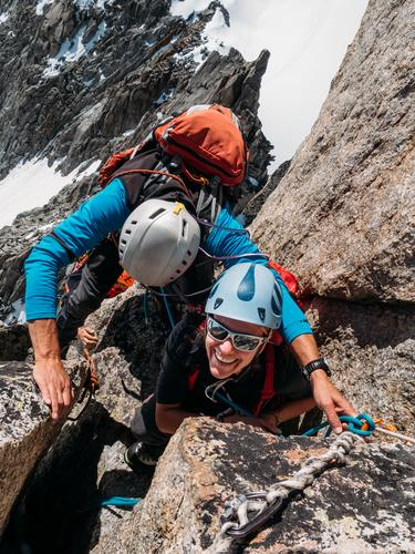 female climber at the top of the mountain peak Lifestyle Joy Happy Beautiful Vacation & Travel Adventure Freedom Expedition Winter Snow Mountain Hiking Sports