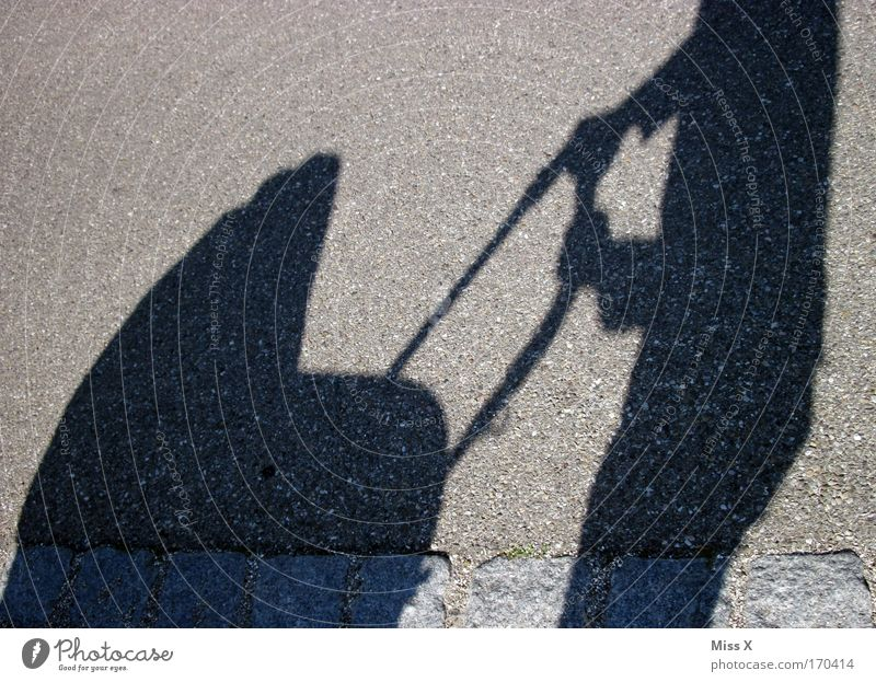 grasp nicely Exterior shot Day Shadow Silhouette Sunlight Parents Adults Mother Father Infancy Life 1 Human being Pedestrian Street Lanes & trails Going Happy