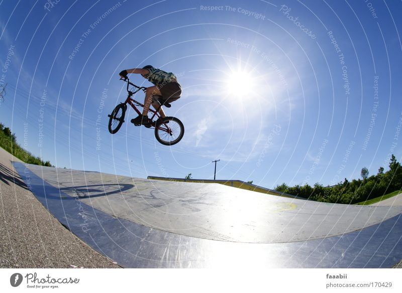 Manfred flies BMX. Colour photo Multicoloured Exterior shot Copy Space right Copy Space bottom Flash photo Fisheye Lifestyle Joy Leisure and hobbies BMX bike