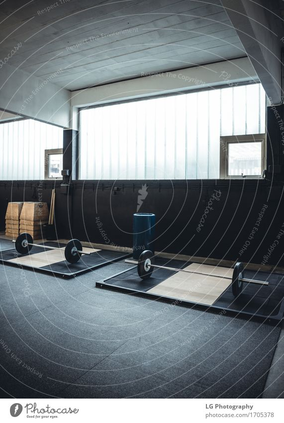 Interior shot of a weightlifting and crossfit gym Body Wellness Club Disco Sports Fitness Strong Power bar bell Body building equipment Practice Story Gymnasium