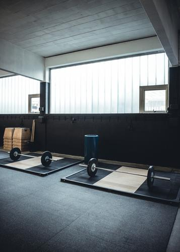 Interior shot of a weightlifting and crossfit gym Sports Body Open Power Fitness Wellness Strong Story Club Disco Musculature Industrial Heavy Practice Lift