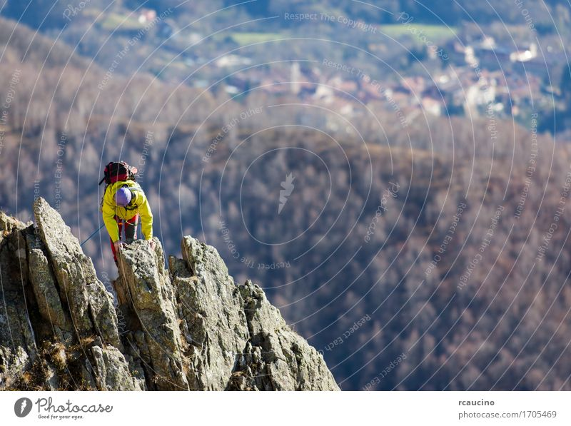 Climber struggle to the summit of a challenging ridge Adventure Mountain Hiking Sports Climbing Mountaineering Rope Human being Man Adults Nature Rock Power
