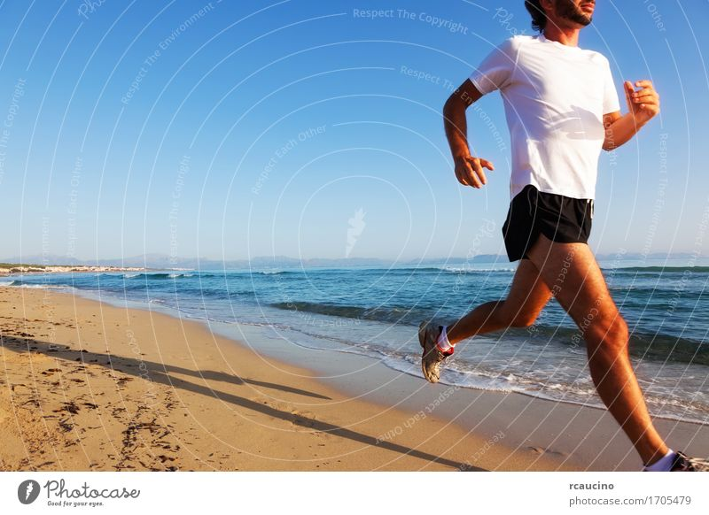 Man running at sunset on a sandy beach in a sunny day Human being Sky Nature Vacation & Travel Man Blue Summer White Ocean Relaxation Beach Adults Sports Coast Lifestyle Sand