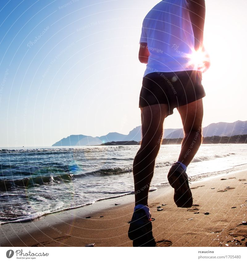 Man running at sunset on a sandy beach Human being Nature Man Ocean Beach Sports Coast Healthy Sand Masculine Fitness Athletic Running Runner Jogging Practice