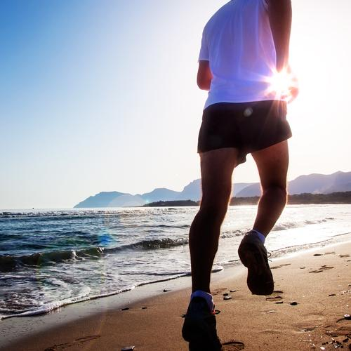 Man running at sunset on a sandy beach Masculine 1 Human being Running Athletic Beach Caucasian Coast Practice Fitness Healthy Jogger Jogging Nature Ocean