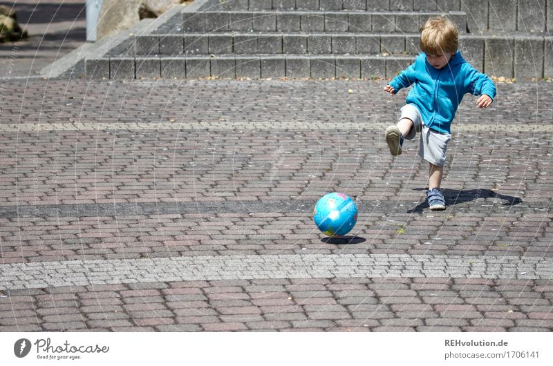 child plays soccer with a ball Sports Foot ball Human being Masculine Child Toddler Boy (child) 1 1 - 3 years Places Movement Playing Small Cute Athletic Blue