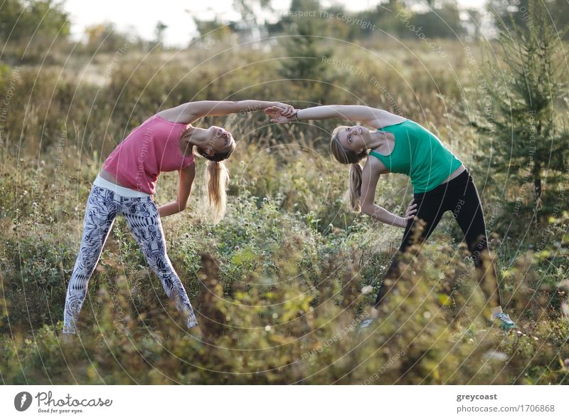 Two supple young women working out together Human being Woman Nature Youth (Young adults) City Beautiful Young woman Landscape Relaxation Girl 18 - 30 years