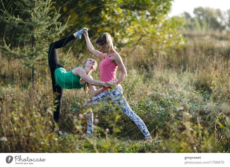Two beautiful gymnasts or dancers working out Elegant Happy Beautiful Summer Garden Sports Yoga Girl Young woman Youth (Young adults) Woman Adults 2 Human being